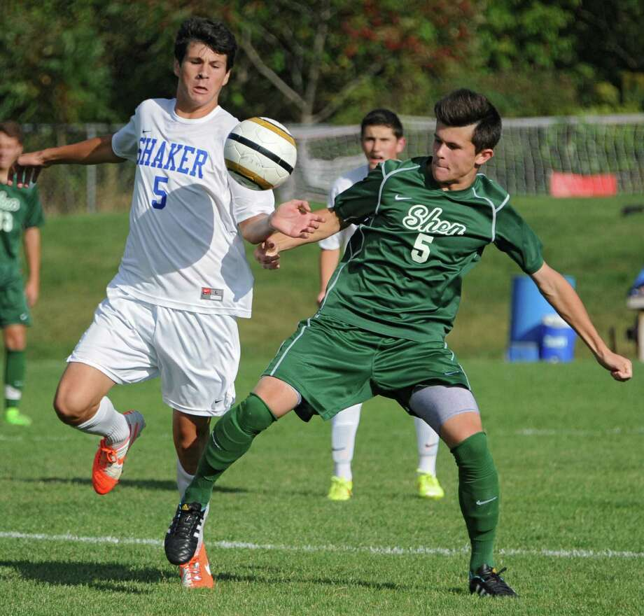 Shaker's Justin Brehm battles for the ball with Shenendehowa's Miles Burbank during a soccer game on Tuesday, Sept. 23, 2014 in Latham, N.Y. (Lori Van Buren / Times Union) Photo: Lori Van Buren / 00028697A