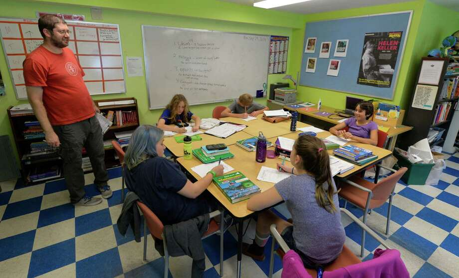 Middle School teacher Dan Vollweiler works with students at the Bethlehem Children's School Monday afternoon Sept. 29, 2014 in Bethlehem, N.Y.   The school will be celebrating it's twentieth year of operation later this month.     (Skip Dickstein/Times Union) Photo: SKIP DICKSTEIN / 10028804A
