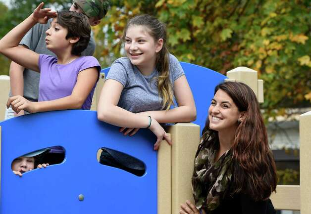 Teacher and skydiver Brittany Pardi, right, joins her students on the jungle gym at the Bethlehem Children's School Monday afternoon Sept. 29, 2014 in Bethlehem, N.Y.   Pardi will be skydiving for a fund raiser for the school.  The school will be celebrating it's twentieth year of operation later this month.     (Skip Dickstein/Times Union) Photo: SKIP DICKSTEIN / 10028804A