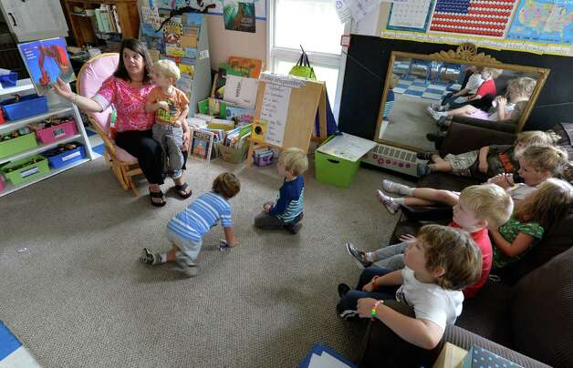 Teacher Simone Paoletti-Albrecht reads to students at the Bethlehem Children's School Monday afternoon Sept. 29, 2014 in Bethlehem, N.Y.   The school will be celebrating it's twentieth year of operation later this month.     (Skip Dickstein/Times Union) Photo: SKIP DICKSTEIN / 10028804A