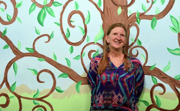 Sara Melita is the new director of the Bethlehem Children's School and stands near their tree of life Monday afternoon Sept. 29, 2014 in Bethlehem, N.Y.   The school will be celebrating it's twentieth year of operation later this month.     (Skip Dickstein/Times Union) Photo: SKIP DICKSTEIN / 10028804A