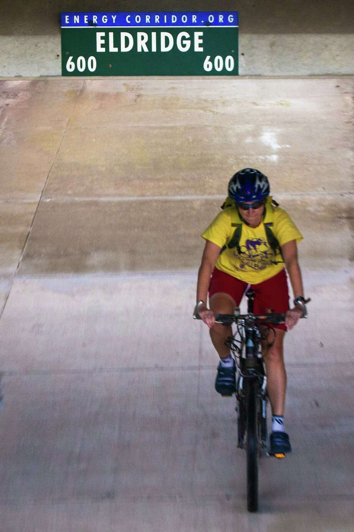 A cyclist speeds on a bike trail that passes under Eldridge Parkway on The Energy Corridor District in Houston. The area has more than 50 miles of scenic trails for bicycles and pedestrians. Monday, Sept. 22, 2014, in Houston. ( Marie D. De Jesus / Houston Chronicle )