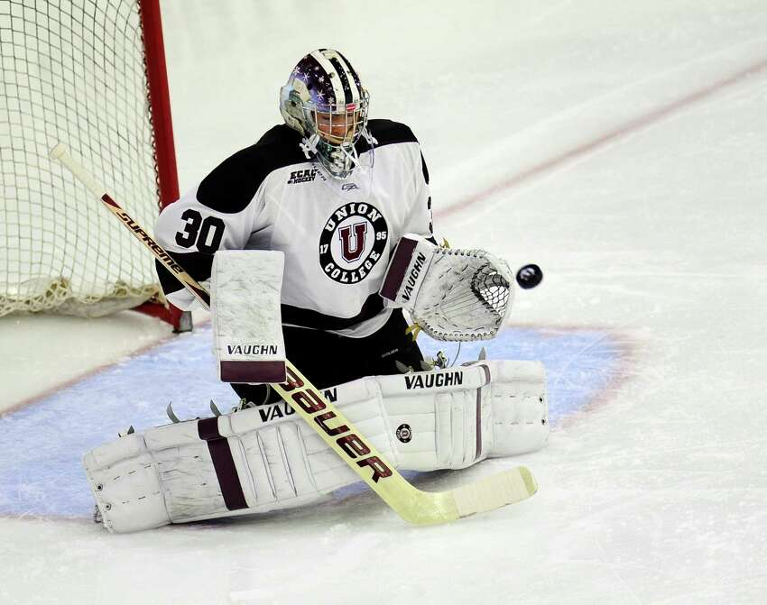 Union goaltender Colin Stevens (30) gloves a Prince Edward Island shot on goal during the second period of an exhibition hockey game on Sunday, Oct. 5, 2014, in Schenectady, N.Y. (Hans Pennink / Special to the Times Union) ORG XMIT: HP102