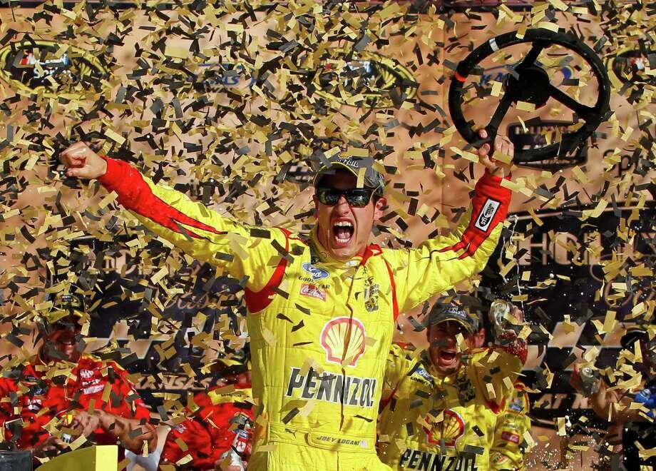 NASCAR Sprint Cup Series driver Joey Logano celebrates his victory in the Hollywood Casino 400 at Kansas Speedway in Kansas City, Kan., Sunday, Oct. 5, 2014. (AP Photo/Colin E. Braley) ORG XMIT: KSCB106 Photo: Colin E. Braley / FR123678 AP