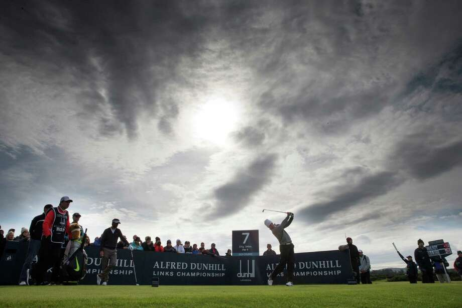 Rory McIlroy tees off at the 7th hole during round three of the Alfred Dunhill Links Championship, in St Andrews, Scotland,  Sunday, Oct. 5, 2014.  Oliver Wilson held off Rory McIlroy to capture his first European Tour title with a one-shot victory in the Alfred Dunhill Links Championship. (AP Photo/PA, Kenny Smith)  UNITED KINGDOM OUT NO SALES NO ARCHIVE  ORG XMIT: LON811 Photo: Kenny Smith / PA