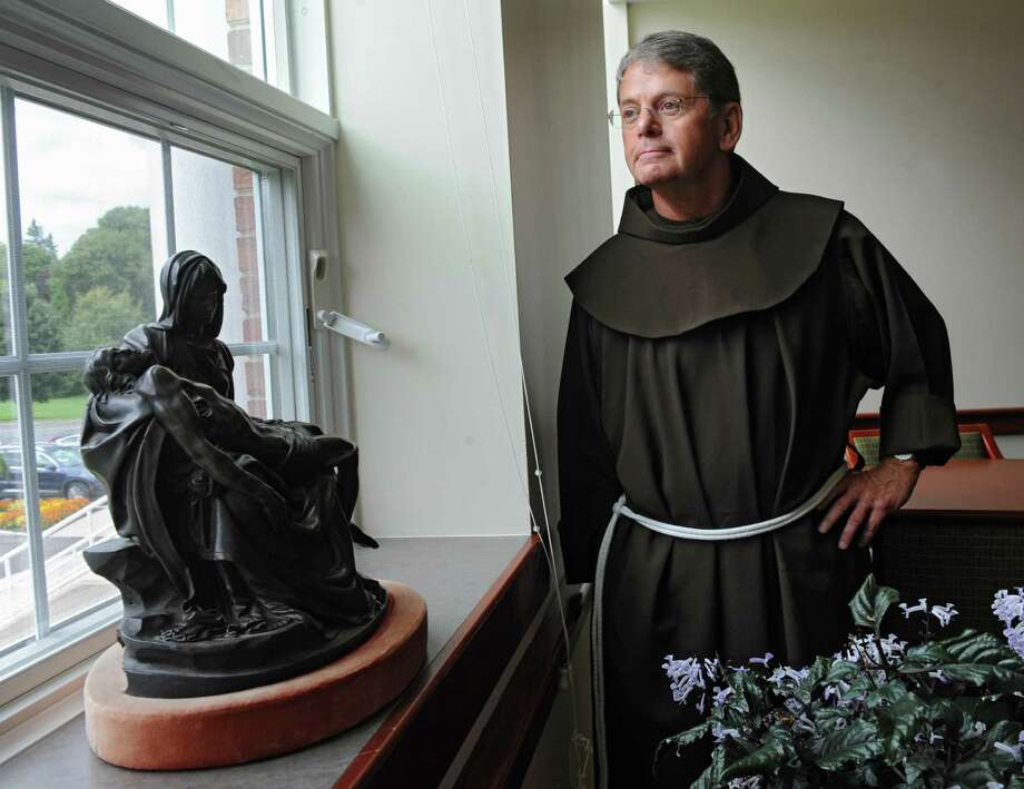 New interim Siena President Br. F. Edward Coughlin stands in the President's Suite at the college on Tuesday, Sept. 16, 2014 in Loudonville, N.Y. (Lori Van Buren / Times Union) Photo: Lori Van Buren / 00028355A