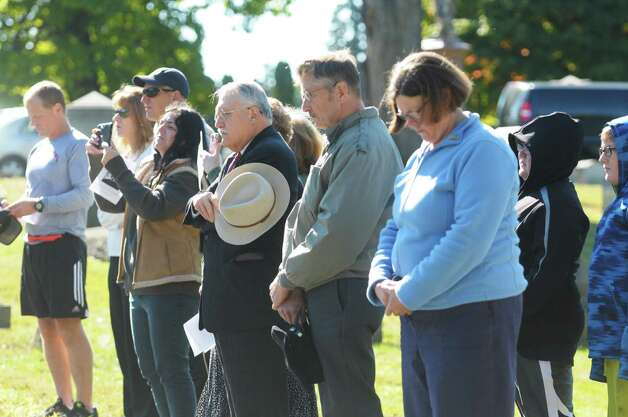 People watch a Presidential Wreath Laying Ceremony at the grave of Chester Arthur, 21st U.S. President, on Sunday, Oct. 5, 2014, at Albany Rural Cemetery in Menands, N.Y. Arthur, who was a Vice President and a President of the U.S., was born in Fairfield, VT and was a graduate of Union College. Vice President Arthur became President in 1881 after President James Garfield was assassinated.  (Paul Buckowski / Times Union) Photo: Paul Buckowski / 00028878A