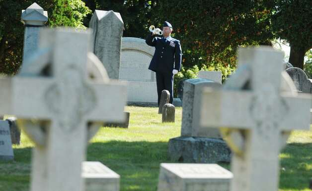 Master Sergeant Alan Moon with the New York Air National Guard plays Taps at a Presidential Wreath Laying Ceremony at the grave of Chester Arthur, 21st U.S. President, on Sunday, Oct. 5, 2014, at Albany Rural Cemetery in Menands, N.Y. Arthur, who was a Vice President and a President of the U.S., was born in Fairfield, VT and was a graduate of Union College. Vice President Arthur became President in 1881 after President James Garfield was assassinated.  (Paul Buckowski / Times Union) Photo: Paul Buckowski / 00028878A
