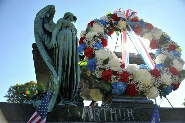 A wreath from President Obama is seen following a Presidential Wreath Laying Ceremony at the grave of Chester Arthur, 21st U.S. President, on Sunday, Oct. 5, 2014, at Albany Rural Cemetery in Menands, N.Y. Arthur, who was a Vice President and a President of the U.S., was born in Fairfield, VT and was a graduate of Union College. Vice President Arthur became President in 1881 after President James Garfield was assassinated.  (Paul Buckowski / Times Union) Photo: Paul Buckowski / 00028878A