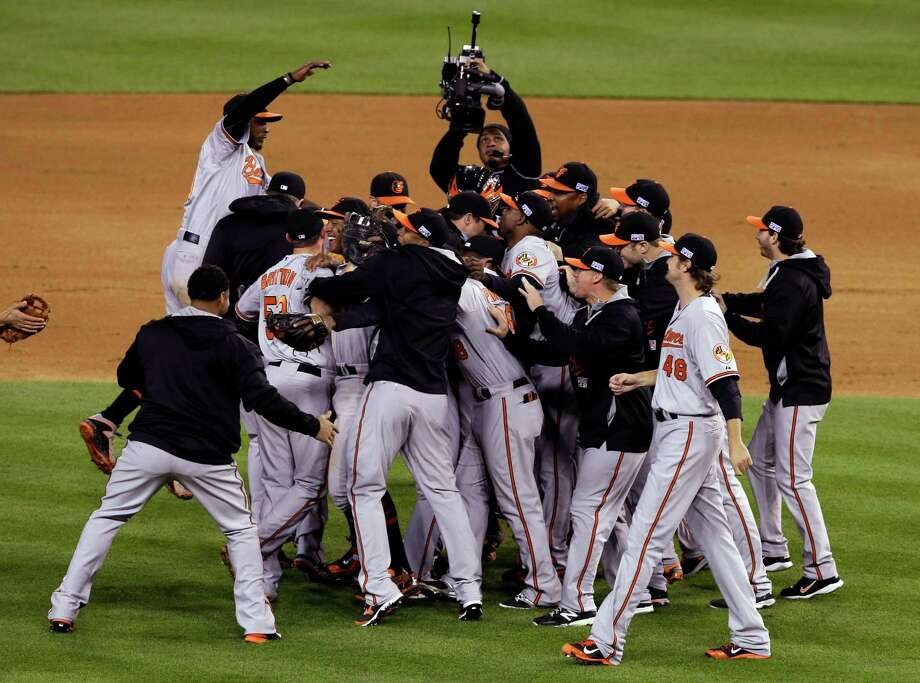 Baltimore Orioles players celebrate after defeating the Detroit Tigers, 2-1 in Game 3 of baseball's AL Division Series Sunday, Oct. 5, 2014, in Detroit. Baltimore won the series 3-0. (AP Photo/Darron Cummings) ORG XMIT: MIDC148 Photo: Darron Cummings / AP