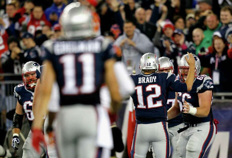 FOXBORO, MA - OCTOBER 05:  Tom Brady #12 of the New England Patriots reacts after throwing a touchdown pass during the third quarter against the Cincinnati Bengals at Gillette Stadium on October 5, 2014 in Foxboro, Massachusetts.  (Photo by Jim Rogash/Getty Images) ORG XMIT: 507867377 Photo: Jim Rogash / 2014 Getty Images