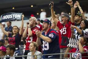 Houston Texans fans cheer during the fourth quarter of an NFL football game against the Dallas Cowboys at AT&T Stadium on Sunday, Oct. 5, 2014, in Arlington, Texas. ( Brett Coomer / Houston Chronicle )