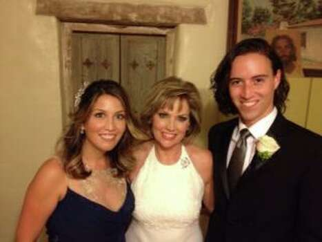 Deborah Knapp looked radiant bookended by her daughter Alicia and son Austin at her Mission San Juan wedding. Photo: Courtesy