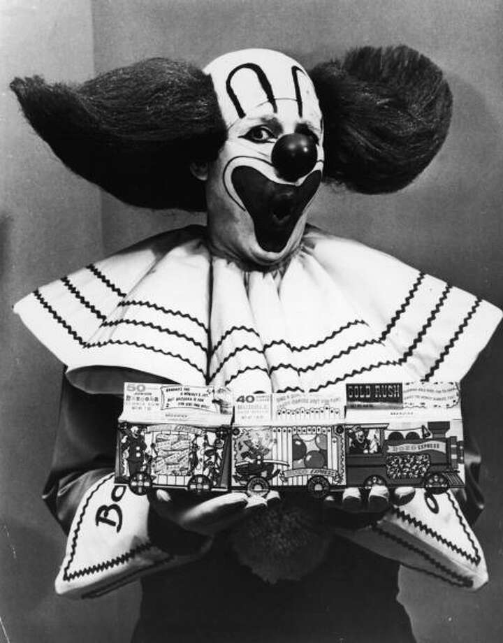 Promotional portrait of Bozo the Clown holding boxes of Bozo Express Bazooka bubble gum with a surprised expression on his face, circa 1965. Photo: Hulton Archive, Getty Images / 2003 Getty Images