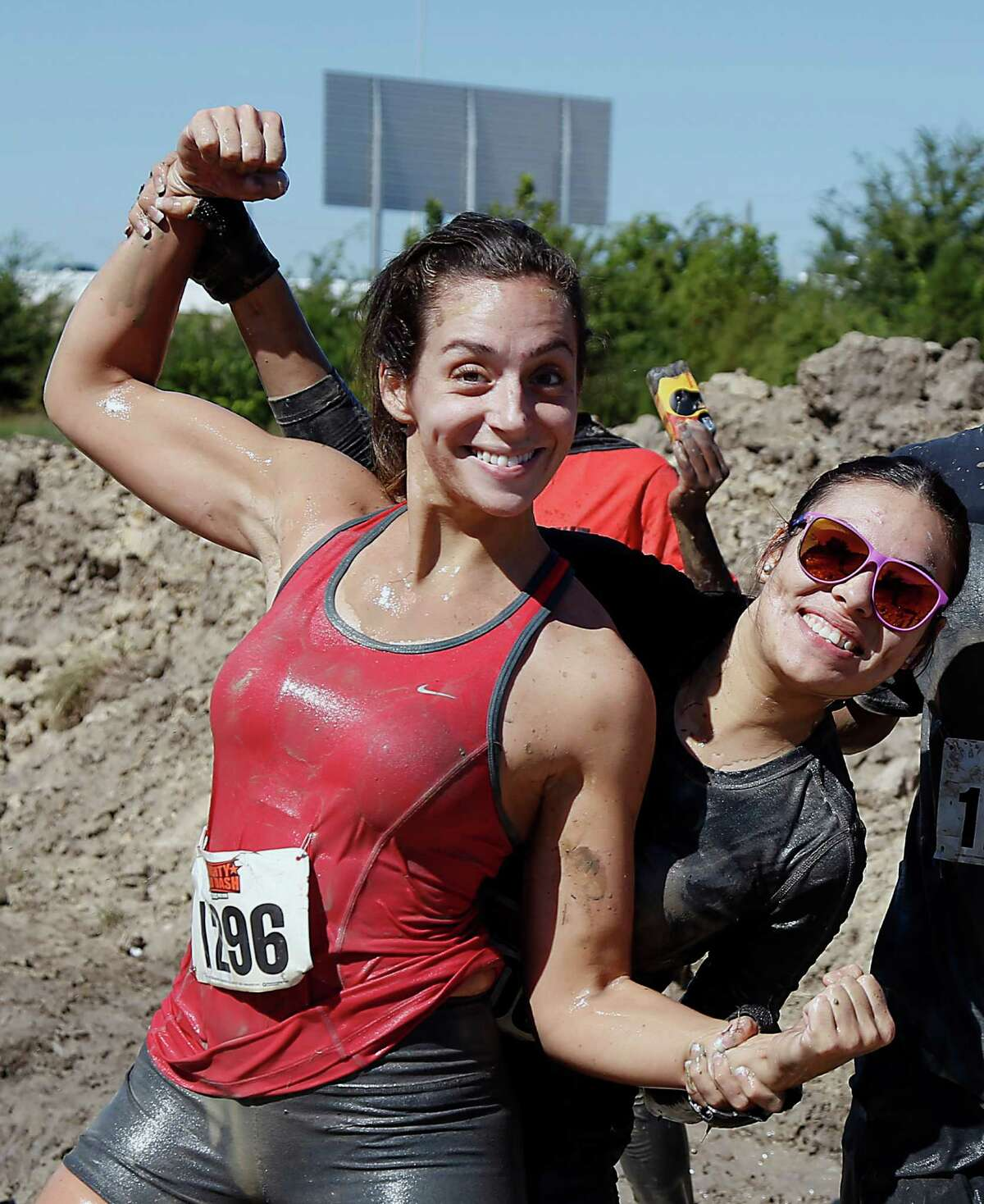 Dashers pose for a photograph during the MIGHTY MUD DASH 5k challenge Sunday, Oct. 5, 2014, in Houston. The dash has 20+ Military style obstacles.