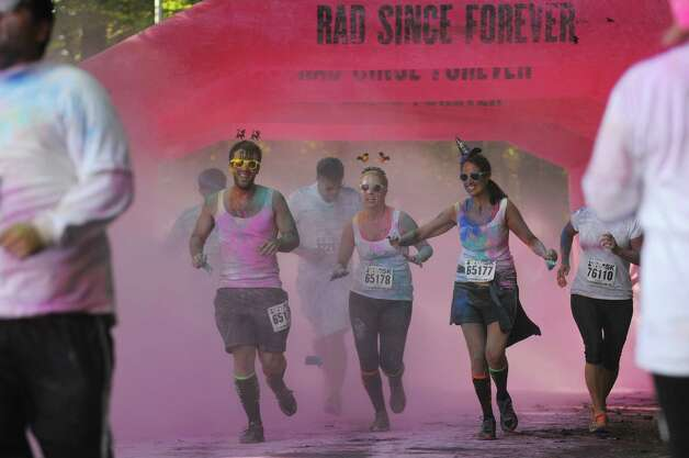 Runners taking part in the Color Me Rad run make their way through the course during the event at Saratoga Spa State Park on Sunday, Oct. 5, 2014, in Saratoga Springs, N.Y.  The Utah-based company said it tries to be clear that it's not a charity run. (Paul Buckowski / Times Union) Photo: Paul Buckowski / 00028840A