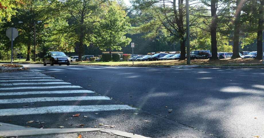The scene outside New Canaan High School's entrance Monday October 6, 2014 about an hour and a half after a 14-year-old student was struck by a car on Farm Road on his way to classes. Photo: Nelson Oliveira / New Canaan News