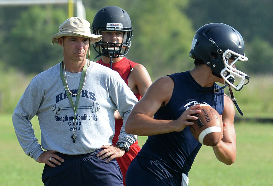 Hardin-Jefferson's Dwayne DuBois watches his son Camden Dubois run drills during practice on Thursday. Photo taken Thursday, August 07, 2014 Guiseppe Barranco/@spotnewsshooter Photo: Guiseppe Barranco, Photo Editor