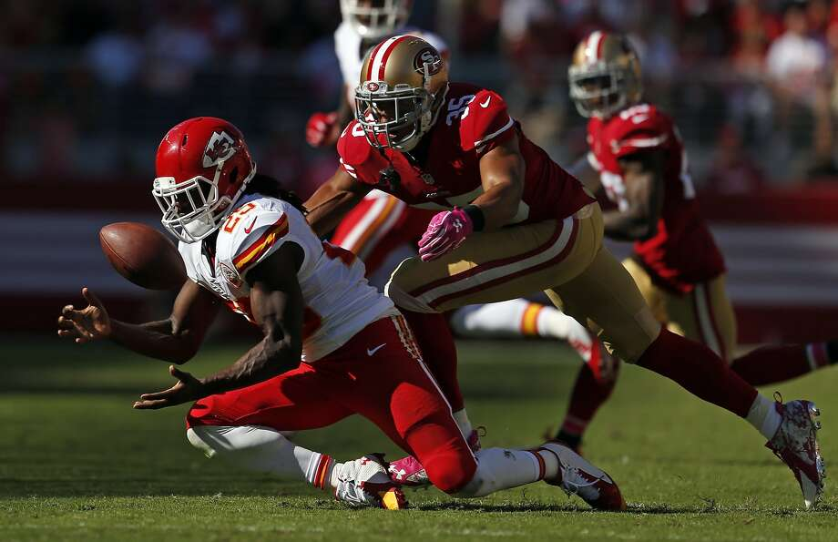 Kansas City Chiefs' Jamaal Charles bobbles the ball before making a catch against San Francisco 49ers' Eric Reid in 3rd quarter of Niners' 22-17 win during NFL game at Levi's Stadium in Santa Clara, Calif. on Sunday, October 5, 2014. Photo: Scott Strazzante, The Chronicle