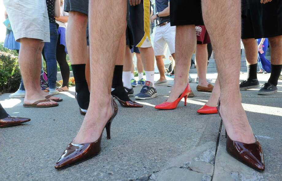 Some of the male students donned high heels for a Walk A Mile In Her Shoes event at Union College on Friday, Oct. 3, 2014 in Schenectady, N.Y. The event was to raise awareness for sexual assault. (Lori Van Buren / Times Union) Photo: Lori Van Buren / 10028788A