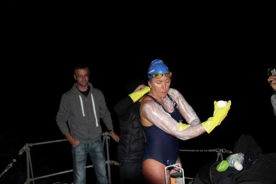 Kim Chambers slathers on jellyfish repellent and lanolin during her swam across the North Channel from northern Ireland to Scotland, on Sept. 2, 2014. It took her 13 hours and 6 mins in 14 degree Celsius water. Photo: Courtesy Of Kim Chambers / ONLINE_YES