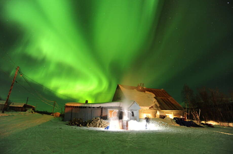 The northern lights dance across the sky over the Takotna checkpoint during the 2011 Iditarod Trail Sled Dog Race on Wednesday night March 9, 2011. Photo: Anchorage Daily News, Getty Images / 2011 MCT