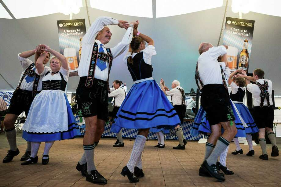 People dance to one of the many bands performing during the first weekend of the annual Leavenworth Oktoberfest on Saturday, Oct. 4, 2014, in Leavenworth, Washington. The first Leavenworth Oktoberfest was held in October 1998 and was attended by about 400 people. Today more than 1 million tourists come to Leavenworth each year to celebrate. Leavenworth Oktoberfest continues on Oct. 10-11 and 17-18. Photo: JORDAN STEAD, SEATTLEPI.COM / SEATTLEPI.COM