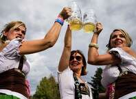 Women dressed in traditional Dirndl dresses toast for a picture outside of a beer hall on the first weekend of the annual Leavenworth Oktoberfest Saturday, October 4, 2014, in Leavenworth, Washington. The first Leavenworth Oktoberfest was held in October 1998 which was attended by about 400 people. Today more than a million tourists come to Leavenworth each year to celebrate. Leavenworth Oktoberfest continues on October 10-11 and 17-18.