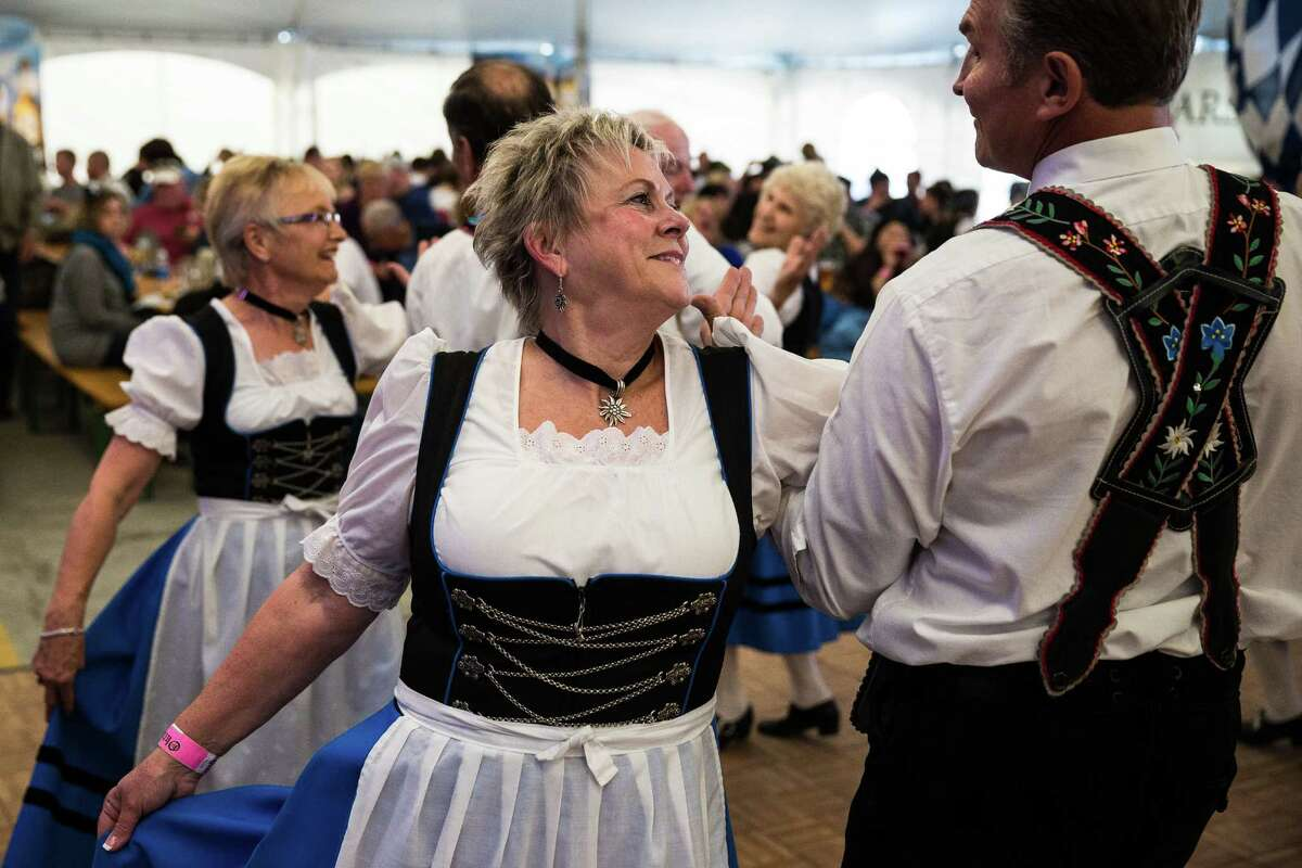 People dance to one of the many bands performing during the first weekend of the annual Leavenworth Oktoberfest Saturday, October 4, 2014, in Leavenworth, Washington. The first Leavenworth Oktoberfest was held in October 1998 which was attended by about 400 people. Today more than a million tourists come to Leavenworth each year to celebrate. Leavenworth Oktoberfest continues on October 10-11 and 17-18.