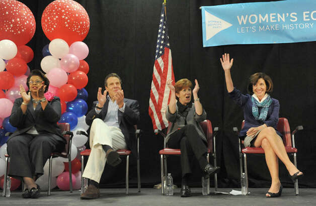 Left to right, Albany County Democratic Committee Chairwoman Carolyn McLaughlin,Gov. Andrew Cuomo ,Albany Mayor Kathy Sheehan and LG Nominee Kathy Hochul attend at rally to build support for the women's equality agenda at the Albany Labor Temple on Saturday Oct. 4, 2014 in Albany, N.Y.  (Michael P. Farrell/Times Union) Photo: Michael P. Farrell, Albany Times Union / 00028882A