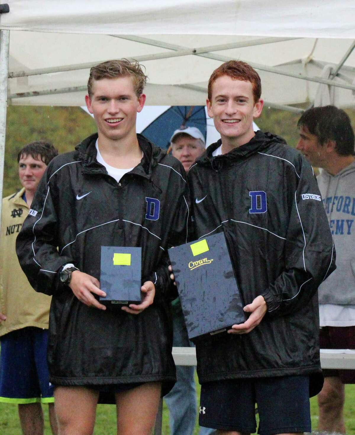 Darien's Alex Ostberg, right, and Armstrong Noonan, left, and pose after finishing first and second, respectively, at the Woods Trail Run at Thetford Academy in Thetford, V.T., on Saturday, Oct. 4.