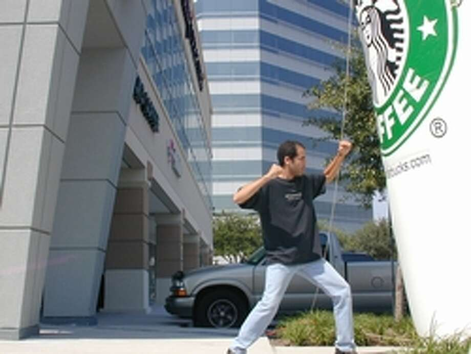 The Houston native has spent 17 years and $100,000 trying to visit every Starbucks in the world. Here he is at the store at I-10 & Memorial City Way.Photos: Check out just some of the Starbucks he has visited in the past 17 years from around the world ... Photo: Winter/Starbuckseverywhere.net