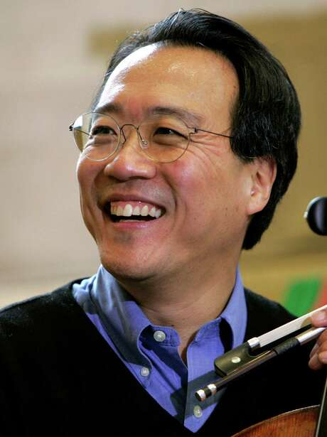 FILE - In this April 26, 2005 file photo, Cellist Yo-Yo Ma performs with members of the Silk Road Ensemble at a noontime concert at the Borders Bookstore Downtown in Boston.  Ma has been chosen to receive the Kennedy Center Honors this year.   (AP Photo/Robert E. Klein) Photo: ROBERT E KLEIN, Associated Press / RBKLN ROBERT KLEIN