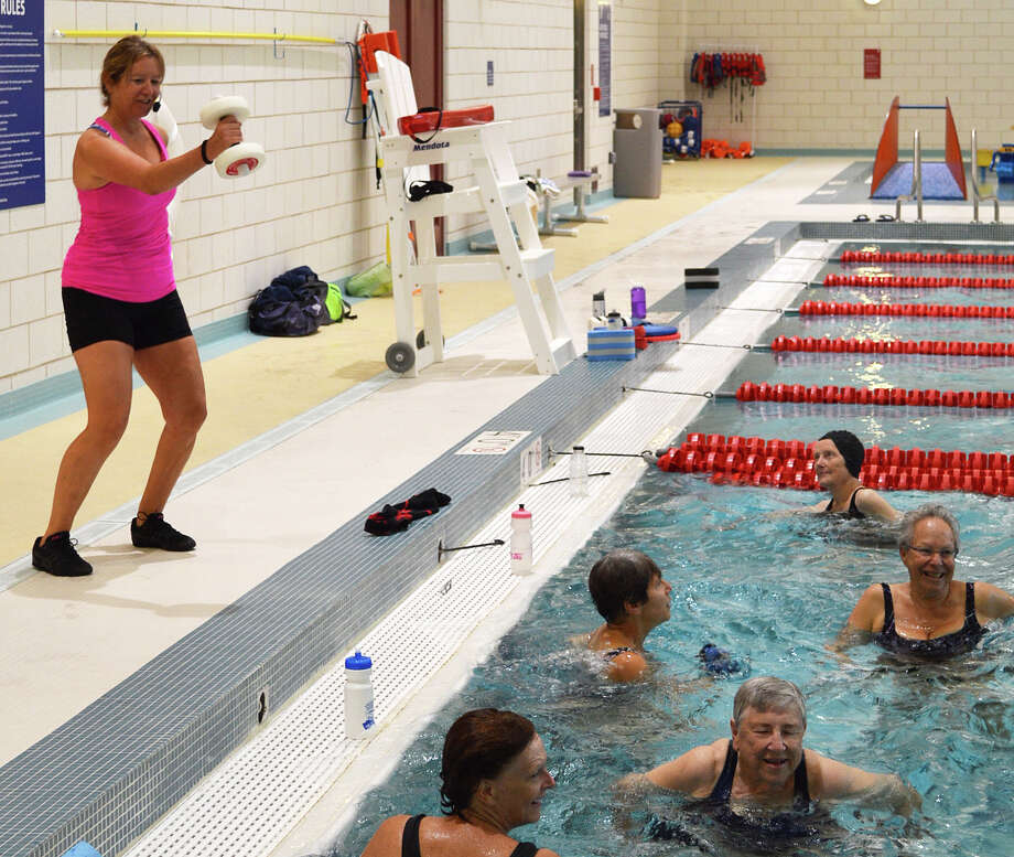 Patty Konda, aquatics fitness instructor, leads a class early Monday at the Westport Y's newly opened Bedford Family Center. Photo: Jarret Liotta / Westport News