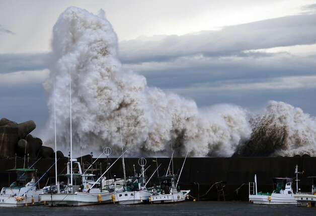 High waves batter a breakwater at a port at Kihou town in Mie prefecture, central Japan on Oct. 6, 2014. Strong typhoon Phanfone slammed into Japan, packing gusts and huge waves that have already swept three US military officials out to sea, as it made a beeline for Tokyo.  Photo: Jiji Press, AFP/Getty Images
