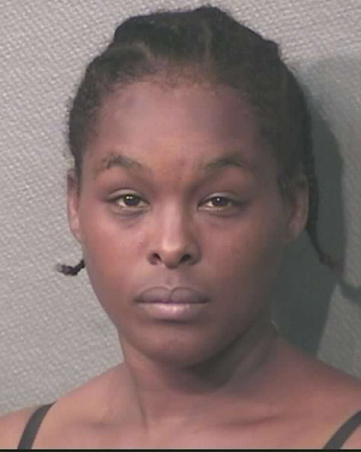 Demetria Johnson is charged with theft of a Houston Fire Department captain's Chevy Suburban, valued at more than $100,000, Oct. 6, 2014. (Houston Police Department)