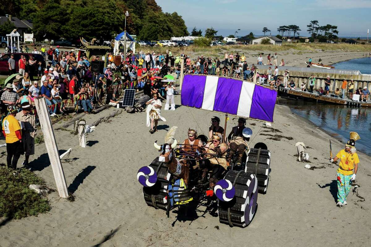Team Valkyrie navigates the sands, populated roads, obstacles and mud pits of the annual Great Port Townsend Bay Kinetic Sculpture Race Sunday, October 5, 2014, in Port Townsend, Washington. Started in 1969 and active in Port Townsend since 1983, the Kinetic Sculpture Race has grown to be a philosophical, artistic, engineering movement with a devoted following worldwide.