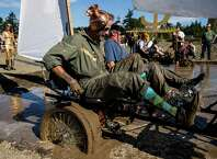 """Decked out in this year's theme of """"gods and goddesses,"""" an eclectic pageantry of human powered machinery populated roads, obstacles and mud pits at the annual Great Port Townsend Bay Kinetic Sculpture Race Sunday, October 5, 2014, in Port Townsend, Washington. Started in 1969 and active in Port Townsend since 1983, the Kinetic Sculpture Race has grown to be a philosophical, artistic, engineering movement with a devoted following worldwide."""