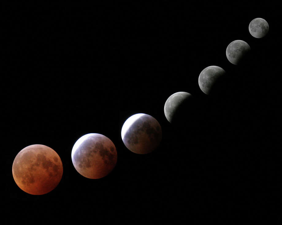 The blood moon is visible during a lunar eclipse as viewed from Delmar, NY, in October 2004. (Paul Block / Times Union)