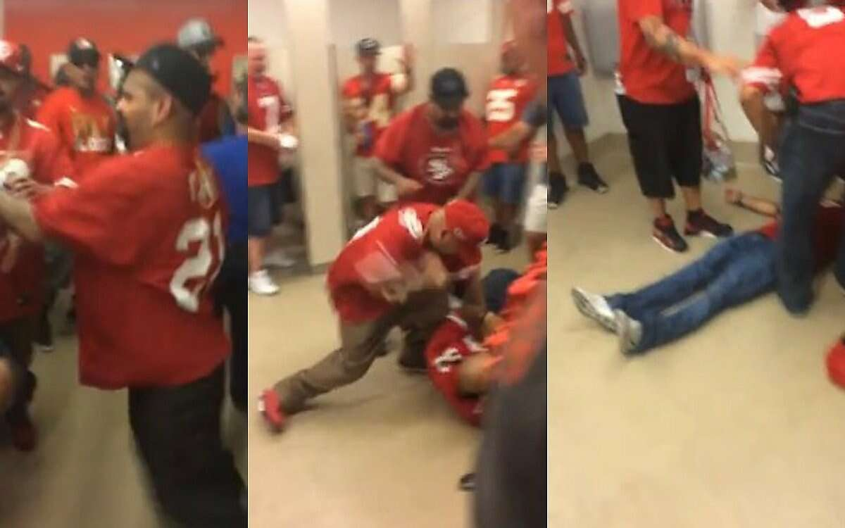 Screen shots from a YouTube video posted Sunday show the beating of two men in the bathroom of Levi's Stadium shortly before kickoff of the San Francisco 49ers game against the Kansas City Chiefs.