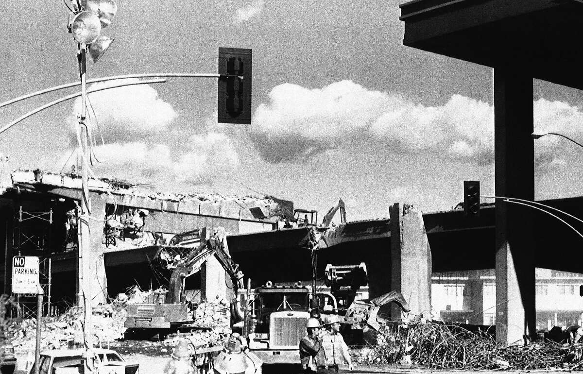 Rubble litters the ground as workers tear down a section of the I-880 Cypress structure on Oct. 25, 1989, in Oakland.