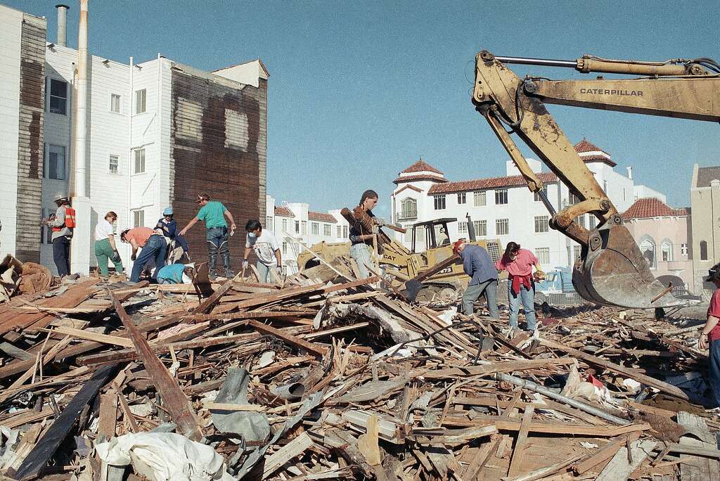former residents of a marina district apartment building search through the rubble for personal belongings