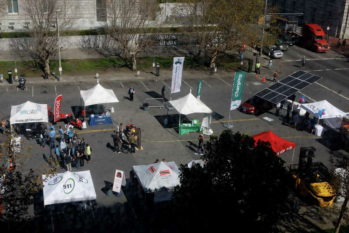 Charge Across Town promotes electric vehicles in the plaza between the San Francisco Main Library and the Asian Art Museum.
