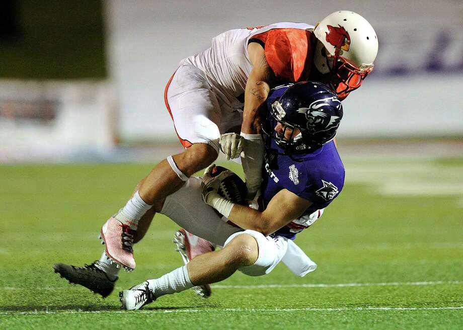 Thomas Metthe/Reporter-News  Lamar safety Kevin Johnson (11) tackles Abilene Christian wide receiver Cade Stone (1) during the fourth quarter of Lamar's 24-21 win on Saturday, Oct. 4, 2014, at Shotwell Stadium in Abilene. (Photo by Tommy Metthe/Abilene Reporter-News) Photo: Thomas Metthe / Tommy Metthe/Abilene Reporter-News