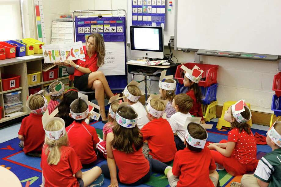 Kindergarten students  at North Mianus Elementary School have been learning about Johnny Appleseed and celebrating everything about apples during the last week of September.  Apple tasting, special hats, painting with apples and other special activities have been thoroughly enjoyed by all. *In the pictures attached, Mrs. O'Neill is reading a story to Mrs. Harris' Kindergarten class after a day full of surprises. Photo: Contributed Photo / Greenwich Time Contributed
