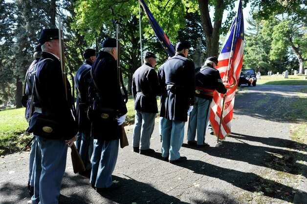 Re-enactors with the 125th New York Regimental Association walk up to take part in a Civil War veteran memorial installation at the grave of James O Connell at the St. Agnes Cemetery on Monday, Oct. 6, 2014, in Menands, N.Y. Seventh and eighth grade students from Holy Spirit School in East Greenbush also took part in the event.  (Paul Buckowski / Times Union) Photo: Paul Buckowski / 00028889A