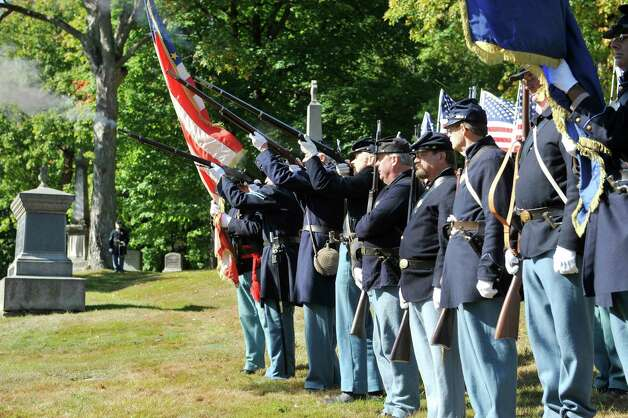 Re-enactors with the 125th New York Regimental Association, fire muskets in salute as they take part in a Civil War veteran memorial installation at the grave of James O Connell at the St. Agnes Cemetery on Monday, Oct. 6, 2014, in Menands, N.Y. (Paul Buckowski / Times Union) Photo: Paul Buckowski / 00028889A