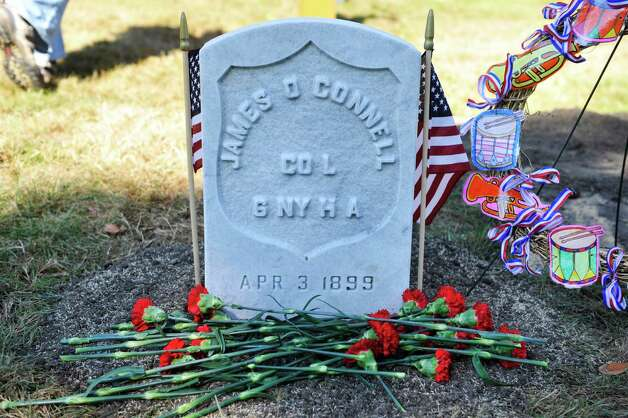 Flowers left by students from Holy Spirit School in East Greenbush are seen following a Civil War veteran memorial installation at the grave of James O Connell at the St. Agnes Cemetery on Monday, Oct. 6, 2014, in Menands, N.Y. (Paul Buckowski / Times Union) Photo: Paul Buckowski / 00028889A