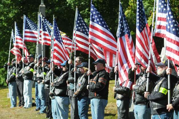 Members of the Patriot Guard Riders hold flags during a Civil War veteran memorial installation at the grave of James O Connell at the St. Agnes Cemetery on Monday, Oct. 6, 2014, in Menands, N.Y. (Paul Buckowski / Times Union) Photo: Paul Buckowski / 00028889A