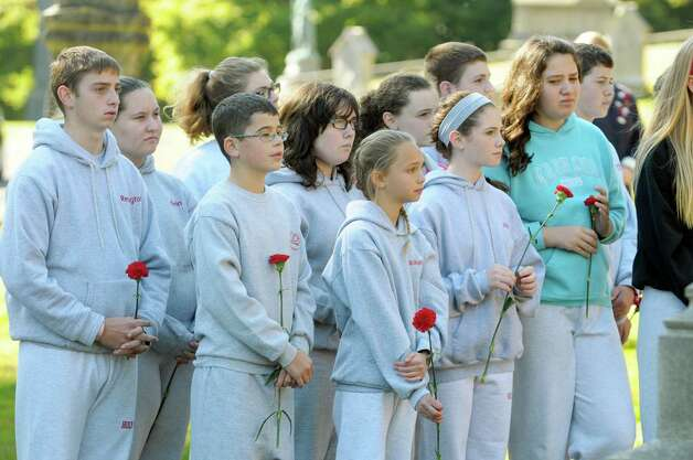 Seventh and eighth graders from Holy Spirit School in East Greenbush take part in a Civil War veteran memorial installation at the grave of James O Connell at the St. Agnes Cemetery on Monday, Oct. 6, 2014, in Menands, N.Y.   (Paul Buckowski / Times Union) Photo: Paul Buckowski / 00028889A
